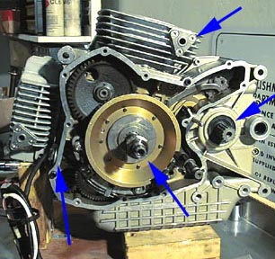 ducati engine rebuild narrower alternator rotor the other arrows point to the new output shaft seal stainless bolts installed in the oil pipe fittings on the barrels